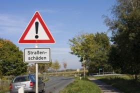 Schild Straßenschäden
